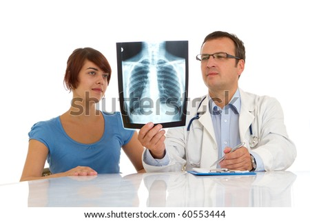 Doctor and patient looking an x-ray image - stock photo