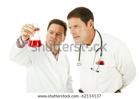 Doctor and scientist working together in lab.  Isolated on white. - stock photo