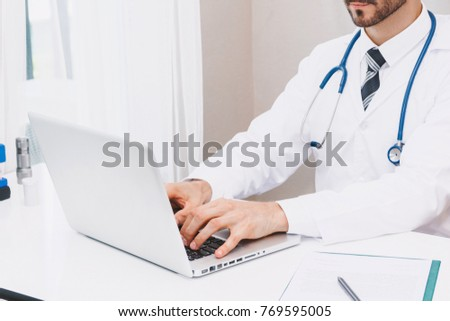 Doctor and stethoscope working with laptop computer in hospital.healthcare and medicine