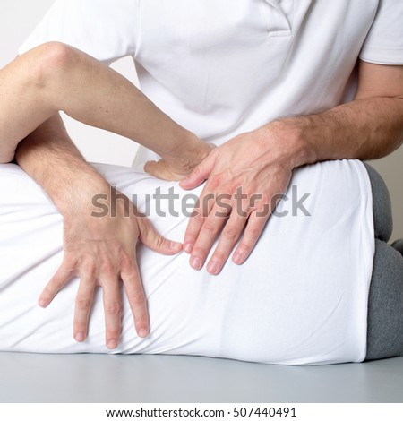 Doctor applying a body manipulation on a female patient