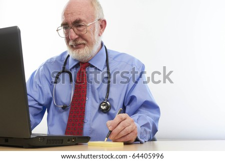 Doctor at desk - stock photo