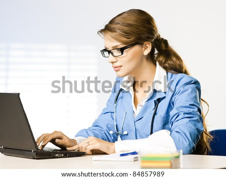 doctor at desk at office - stock photo