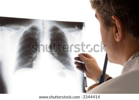 doctor at x-ray equipment - stock photo