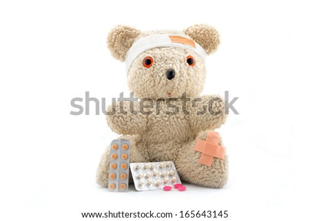 Doctor bear with medicine, isolated on white - stock photo