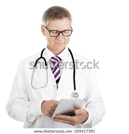 Doctor checking patient notes on a tablet-pc standing with his stethoscope around his neck reading the information on the screen, isolated on white - stock photo