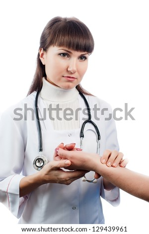 Doctor checking pulse - stock photo