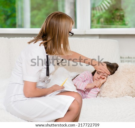 doctor checks the temperature of a girl touching his forehead