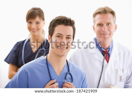 Doctor: Cheerful Physician Leads Medical Team - stock photo