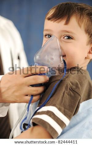 Doctor, child, inhaler mask for breathing, hospital - stock photo