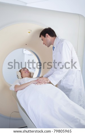 Doctor comforting patient before CT scan - stock photo