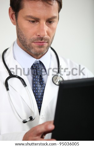 Doctor consulting a chart - stock photo