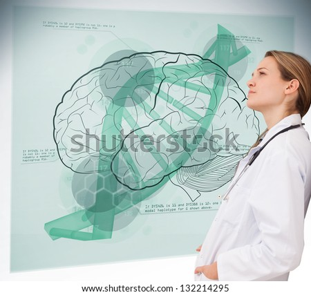 Doctor consulting futuristic green brain interface - stock photo