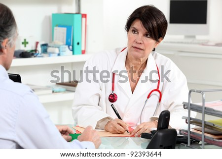 Doctor consulting with a patient - stock photo