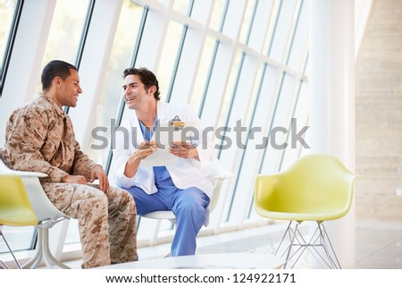 Doctor Counselling Soldier Suffering From Stress - stock photo