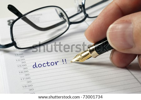 doctor date in calendar - stock photo