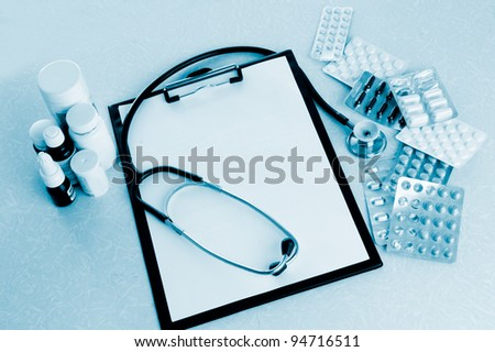 Doctor desk workplace stethoscope, notebook with blank copy space - stock photo