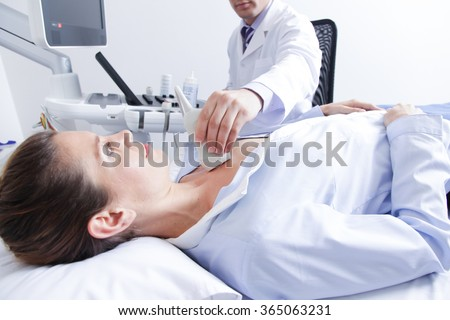 Doctor doing a doppler sonography - stock photo