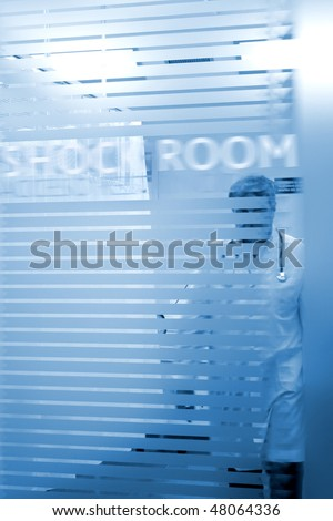 Doctor entering the shock room, medical image - stock photo