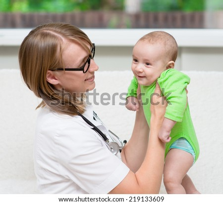 doctor examining a newborn baby - stock photo