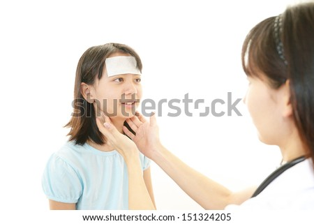 Doctor examining a patient - stock photo