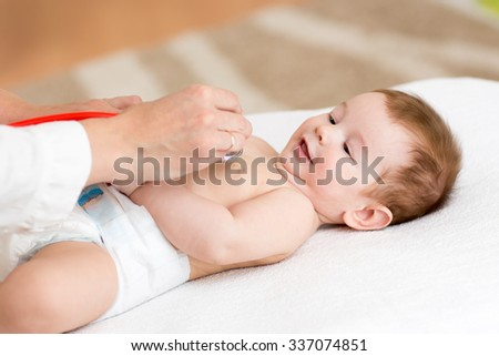 doctor examining baby little boy with stethoscope