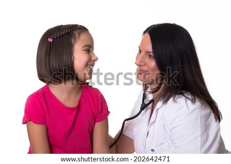 Doctor examining cute girl on white background. - stock photo