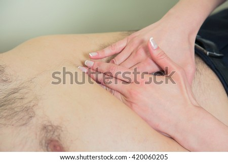 Doctor examining old patient lymph glands, throat inflammation. - stock photo