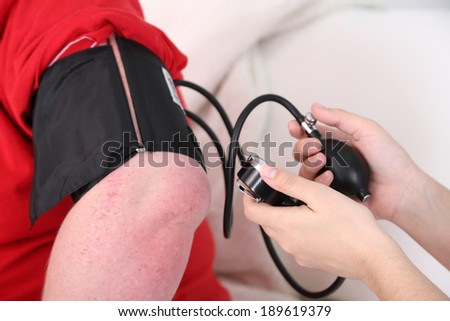 Doctor examining  patient obesity on light background - stock photo