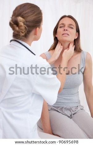 Doctor examining patients painful throat