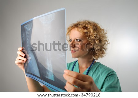 doctor examining skeleton x-ray female isolated