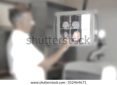 Doctor explaining diagnosis blurred - stock photo