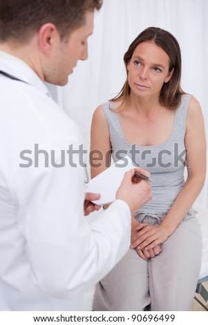 Doctor explaining further steps to his patient - stock photo