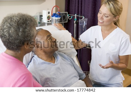 Doctor Explaining To Senior Couple - stock photo