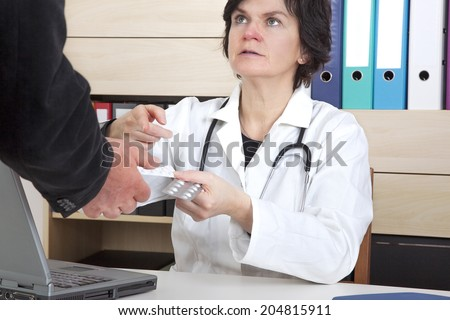 Doctor explains the tablets - stock photo