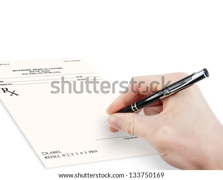 Doctor filling in empty medical prescription - stock photo