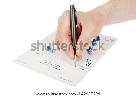 Doctor filling in empty medical prescription
