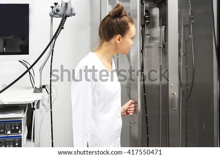 Doctor gastroenterologist. Doctor gastroenterologist with probe to perform gastroscopy and colonoscopy  - stock photo