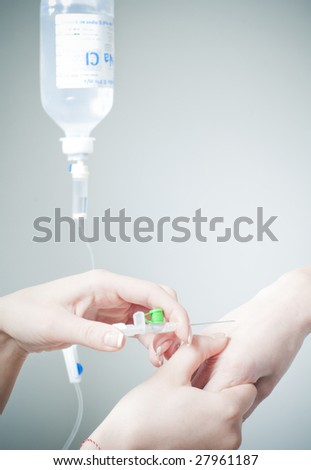 Doctor getting ready to inject patient with sterile syring - stock photo