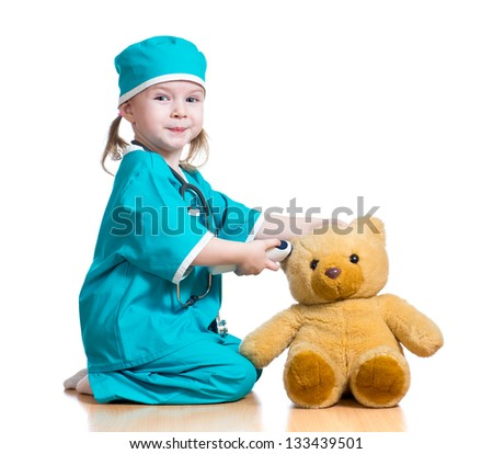 doctor girl playing and measuring  temperature toy - stock photo
