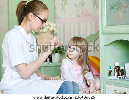 doctor gives a drug to the child - stock photo