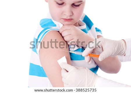 Doctor giving a child injection in arm on isolated image. - stock photo
