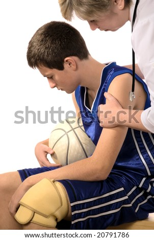 doctor giving first aid the hurt sportsman - stock photo