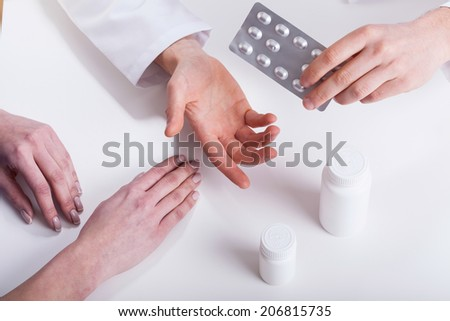 Doctor giving patient medicines closeup isolated hands photo - stock photo