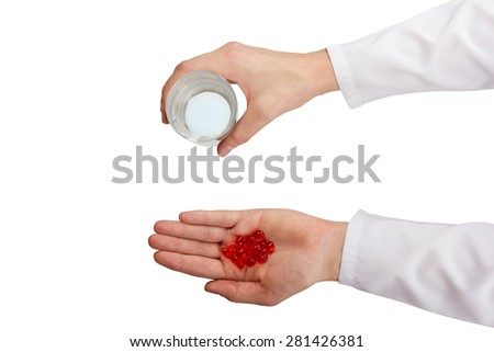 Doctor giving red pills and tablets, hands close up isolated on white background, top view - stock photo