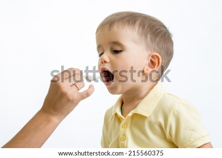 doctor giving remedy feeding with a spoon