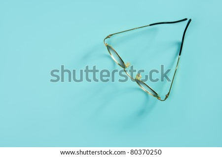 doctor glasses with soft shadow over green desk background - stock photo