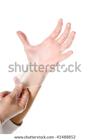 Doctor hand by getting gloves on white background.