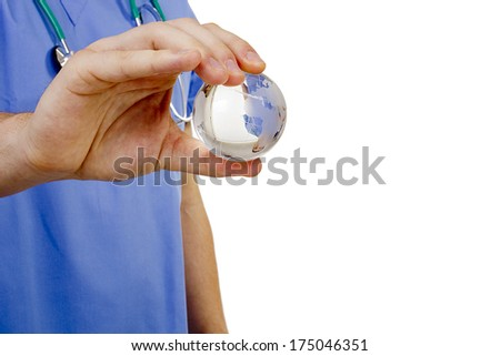 Doctor hand holding a symbolic globe. Global medicine. - stock photo