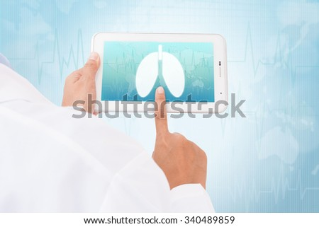 Doctor hand touch screen Lung symbol on a tablet. medical icon - stock photo