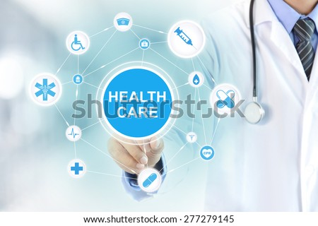 Doctor hand touching HEALTH CARE sign on virtual screen - stock photo